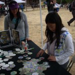 Kids and families engaging with the Puzzle of Life at the 6th annual Santa Monica Mountains Science Fest.